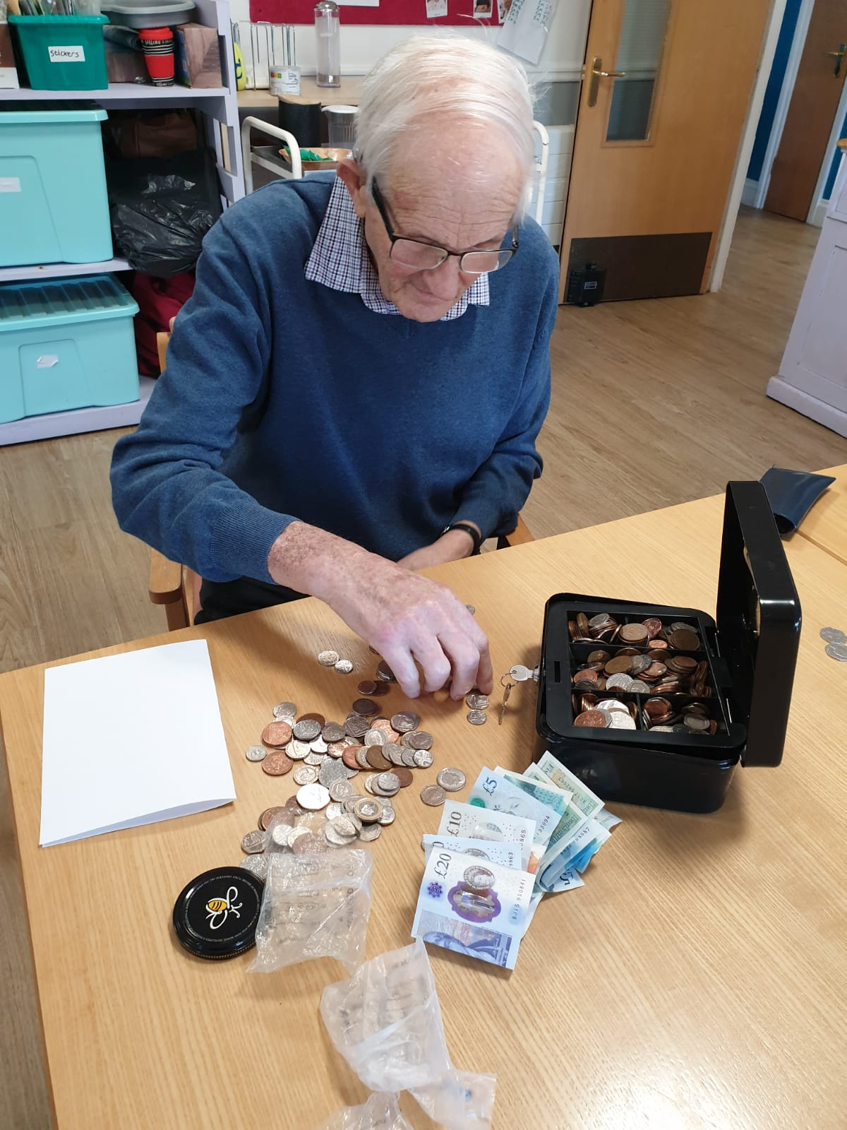 Counting money at The Firs Nursing Home in Taunton